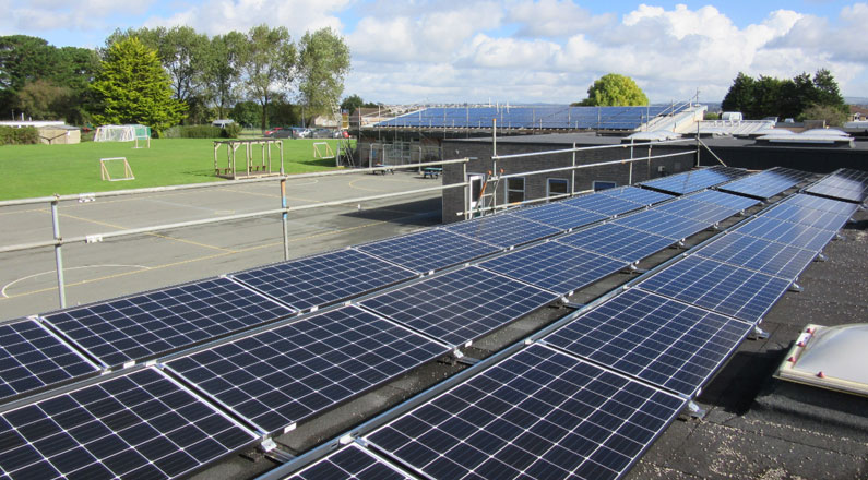 Plymstock School, 100.24kW system we installed for TEC, pictured with an existing 36.75kW system we installed at the school in 2011.