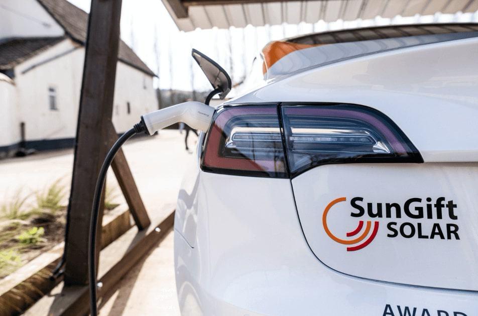 SunGift Tesla charging at SunGift Solar Car Port